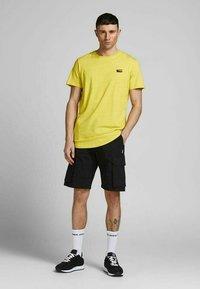 Jack & Jones - SLIM FIT - Print T-shirt - yellow - 1