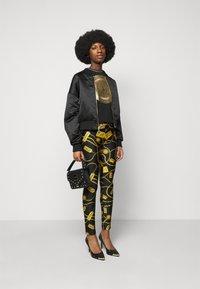 Versace Jeans Couture - Leggings - Trousers - black - 1