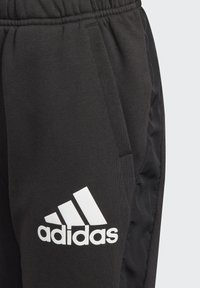 adidas Performance - BADGE OF SPORT FLEECE ATHLETICS REGULAR PANTS - Tracksuit bottoms - black - 4