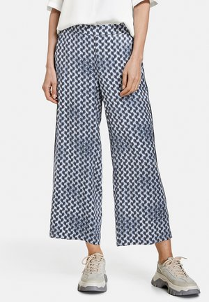 MIT ALLOVERMUSTER - Trousers - dusty blue rose druck