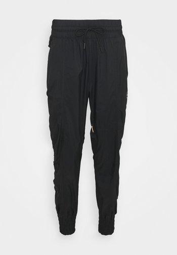 PANT - Pantalones deportivos - black