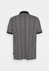 Calvin Klein - LIQUID TOUCH ALLOVER LOGO - Polo shirt - black - 1