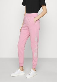 KARL LAGERFELD - RHINESTONE LOGO PANTS - Tracksuit bottoms - pink - 0