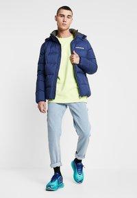 Calvin Klein Jeans - HOODED DOWN PUFFER  - Winter jacket - blue - 1