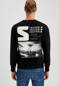 DeFacto - Stickad tröja - black - 2