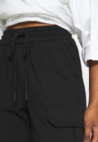 Vero Moda Petite - VMEVA STRING PANT  - Tracksuit bottoms - black - 3