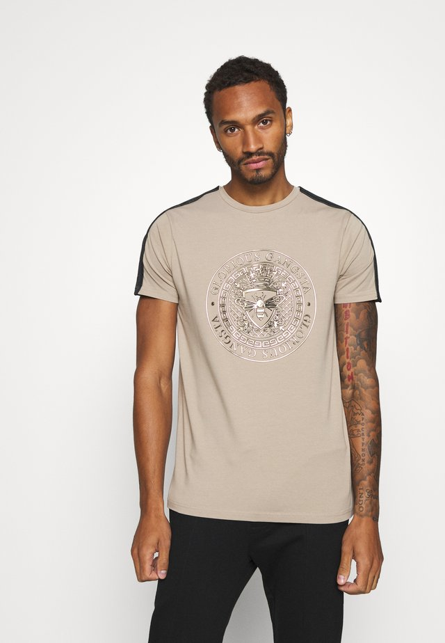 ABILA - T-shirt med print - sand