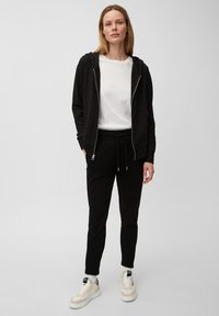 Marc O'Polo - Tracksuit bottoms - black - 1