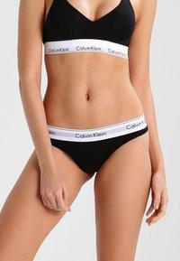 Calvin Klein Underwear - MODERN THONG - Thong - black - 0