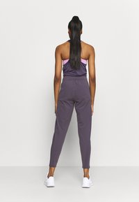 Nike Performance - WARM PANT RUNWAY - Tracksuit bottoms - dark raisin/reflective silver - 2