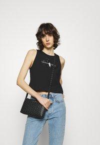Calvin Klein - XBODY MONOGRAM - Across body bag - black - 0