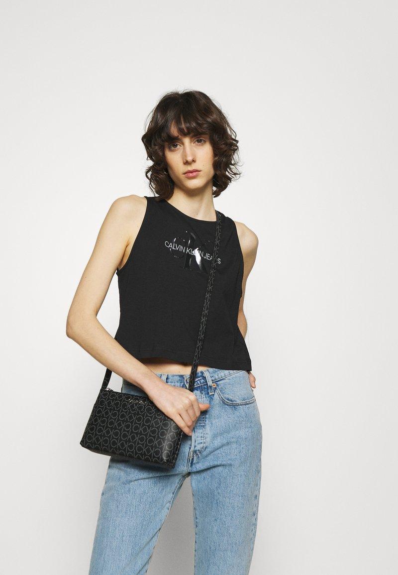 Calvin Klein - XBODY MONOGRAM - Across body bag - black