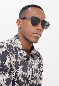 Prada - Sonnenbrille - havana - 1