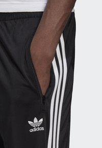 adidas Originals - FIREBIRD UNISEX - Tracksuit bottoms - black - 2