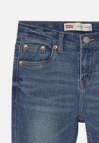 Levi's® - SKINNY TAPER - Jeans Skinny Fit - dark blue denim - 2