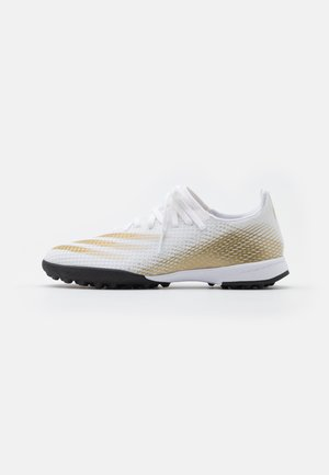 X GHOSTED.3 FOOTBALL BOOTS TURF UNISEX - Astro turf trainers - footwear white/metallic gold/core black