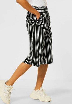 MIT PRINT - Shorts - schwarz