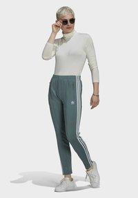adidas Originals - PANTS - Tracksuit bottoms - hazy emerald - 1
