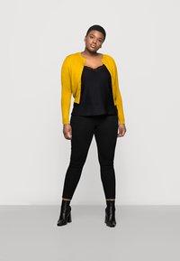 Marks & Spencer London - CREW CARDI PLAIN - Strikjakke /Cardigans - yellow - 1
