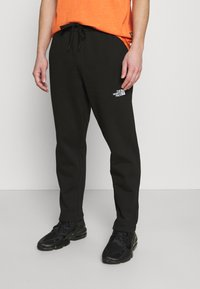 The North Face - STANDARD PANT - Tracksuit bottoms - black - 0