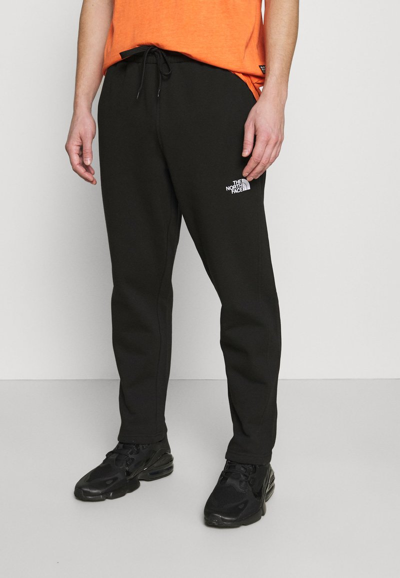 The North Face - STANDARD PANT - Tracksuit bottoms - black