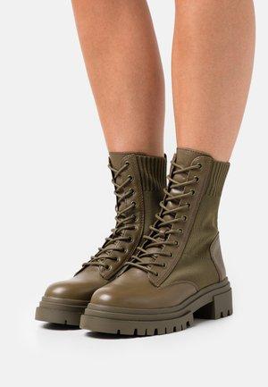 REFLOW - Lace-up ankle boots - khaki