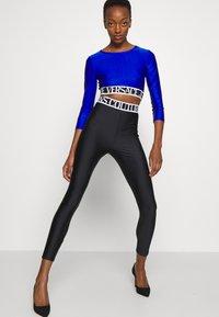Versace Jeans Couture - PANTS - Leggings - Trousers - black - 6