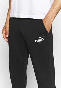 Puma - LOGO PANTS - Tracksuit bottoms - black - 4