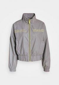 Karl Kani - RETRO SHINY SHORT TRACKJACKET - Summer jacket - grey - 5