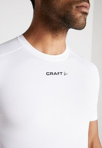 Craft - PRO CONTROL COMPRESSION TEE - T-Shirt print - white - 6