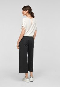QS by s.Oliver - Flared Jeans - black - 2