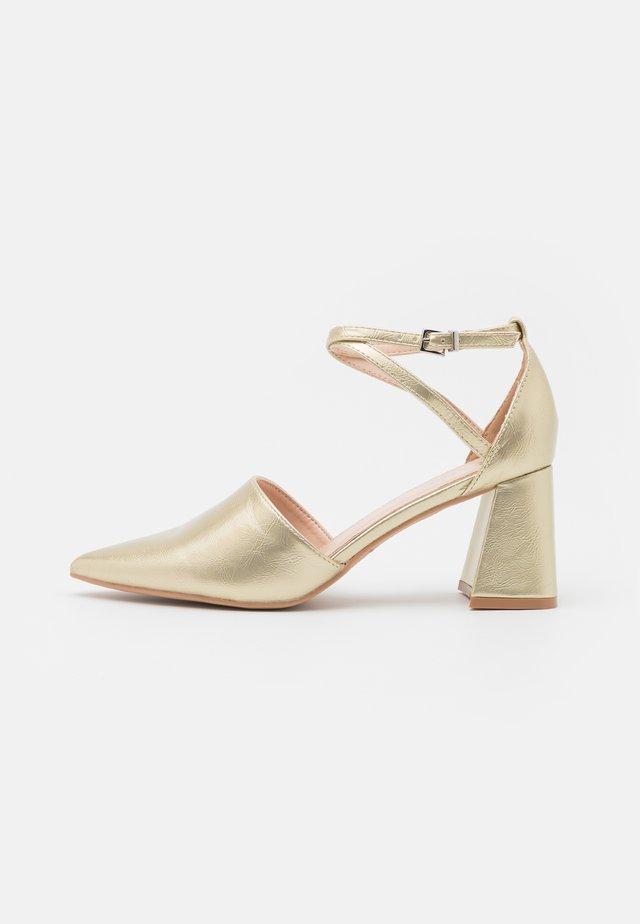 RUHANI - Classic heels - gold