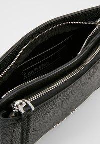 Calvin Klein - SIDED CROSSBODY - Across body bag - black - 4