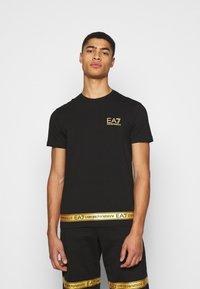 EA7 Emporio Armani - Print T-shirt - black/gold - 0