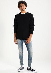 G-Star - 3301 DECONSTRUCTED SUPER SLIM - Slim fit jeans - blue denim - 1