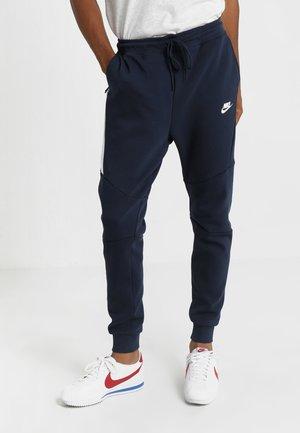 TECH - Pantalon de survêtement - dark blue, white