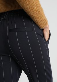 ONLY - ONLPOPTRASH TEMPO STRIPE PANT  - Trousers - night sky/white - 5