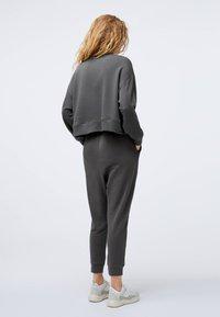 OYSHO - Tracksuit bottoms - dark grey - 2