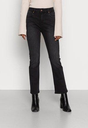 RYAN - Flared jeans - washed black denim