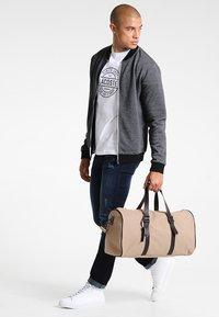 Zalando Essentials - Slim fit jeans - dark blue - 1