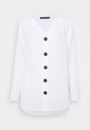 V NECK LONGLINE - Bluser - white