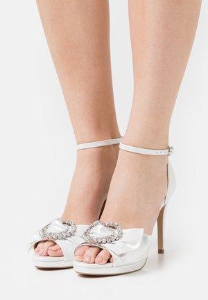 JOJO - Sandalen met plateauzool - white shimmer