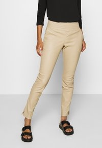 Ibana - COLLETTE - Leather trousers - sand - 0
