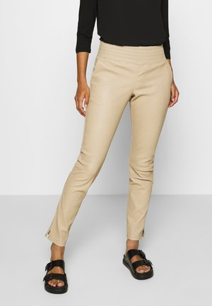 COLLETTE - Leather trousers - sand