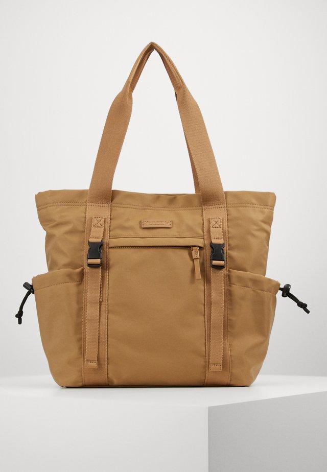 Shopping bag - soaked sand