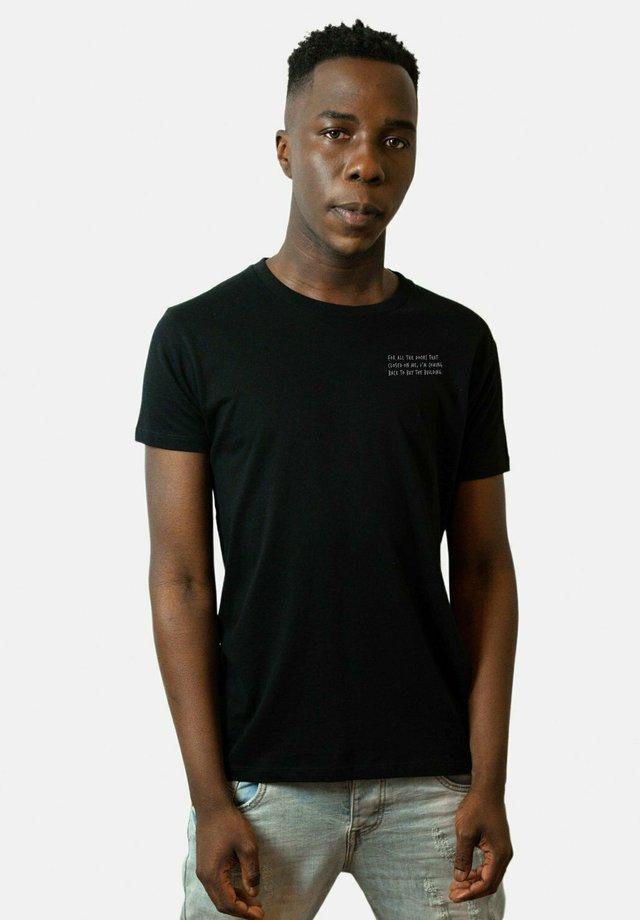 CHALLENGER - T-shirt med print - black