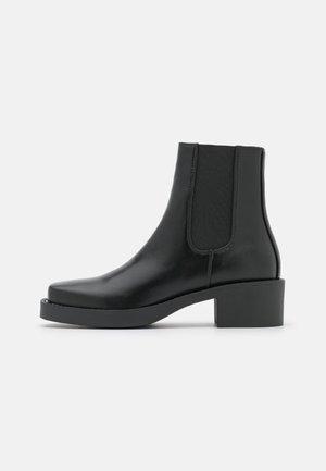 DEMELZA - Kotníkové boty na platformě - black