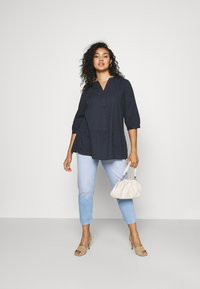 ONLY Carmakoma - CARENEDA LIFE MOM BABY  - Jeans relaxed fit - light blue denim - 1
