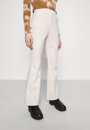 RAMONA TROUSERS - Flared jeans - solid