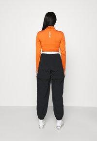 Ellesse - OLTUS TRACK PANT - Pantalones deportivos - black - 2